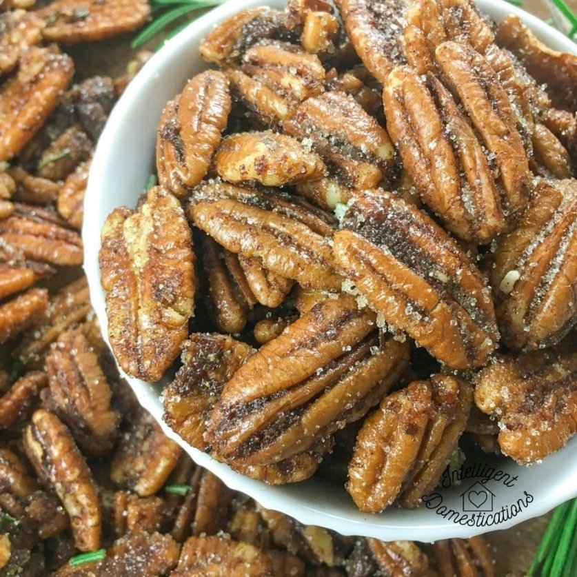 Spiced pecans in a white bowl