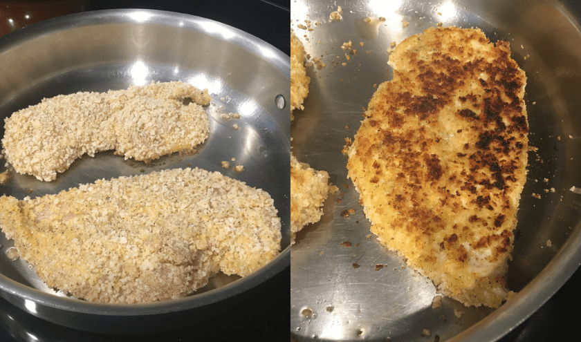 Breaded chicken breast being browed in very shallow oil in a stainless steel skillet