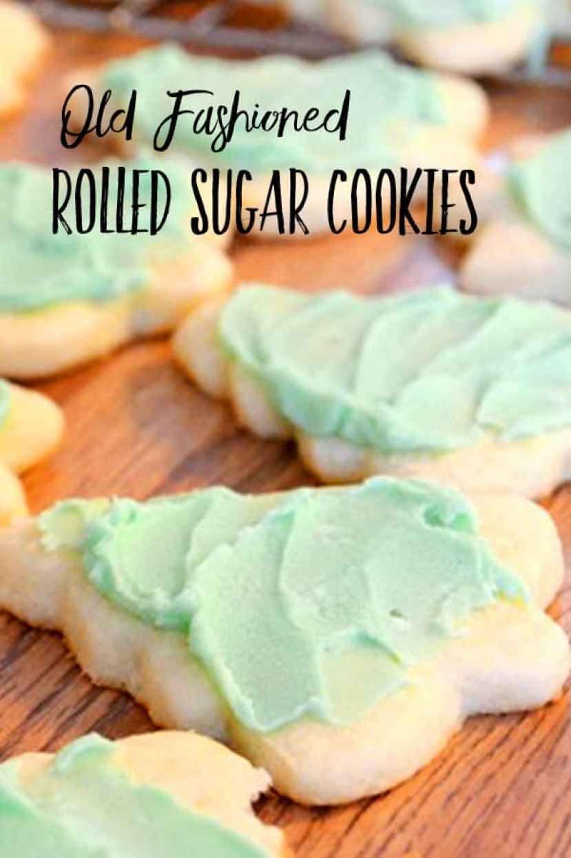Sugar Cookies cut as Christmas trees with green icing