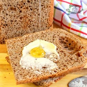 Honey wheat bread sliced with butter and honey