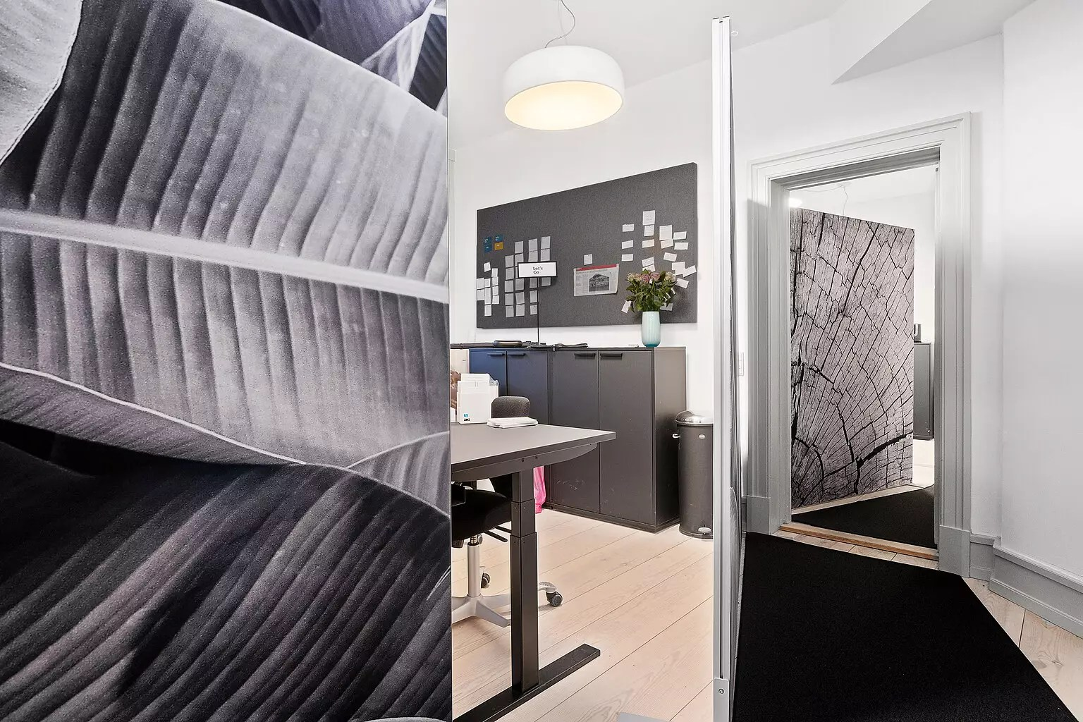 Office at BloxHUB in Copenhagen. Acoustic room dividers with custom prints divide workplaces from walkways. Made by Intelligent Space.