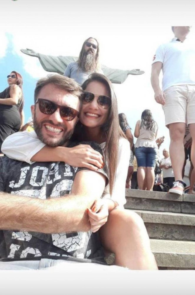 Funny photobomb of couple with Jesus
