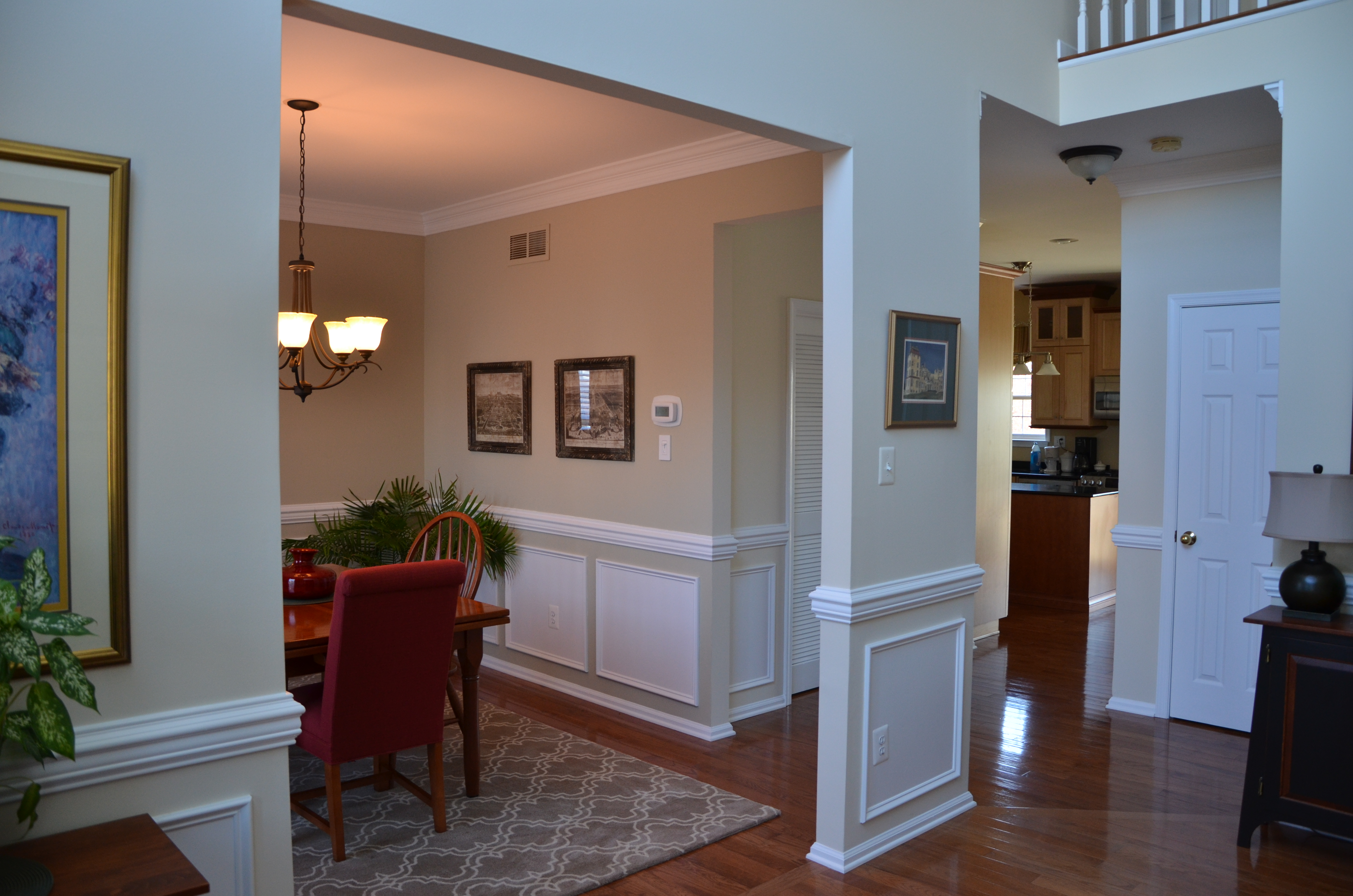 View from Foyer to Kitchen. Intentional Designs, Inc. Photography by dreams come true productions.
