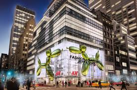H&M Building in NYC. 12' sculpture by Jeff Koons. www.forbes.com