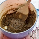 image of easy healthy refried beans in a blue pot with a masher by cindy newland with intentionally eat