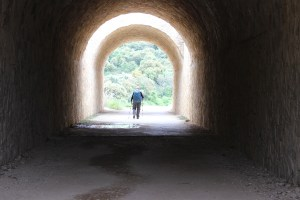 hiker in tunnel