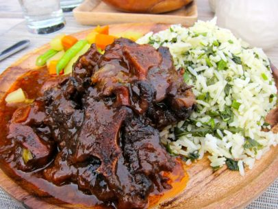 Oxtail and callaloo rice