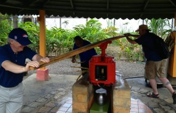 Demonstrating the cane press by hand