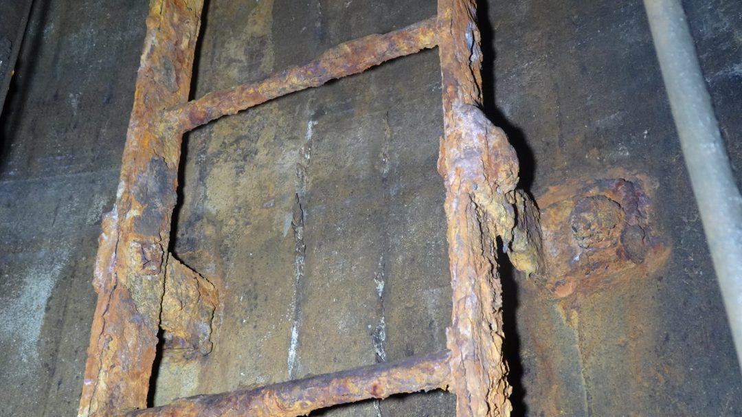 Rusted Ladder in Vertical Shaft