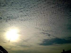 Sun blocked by vapor trails