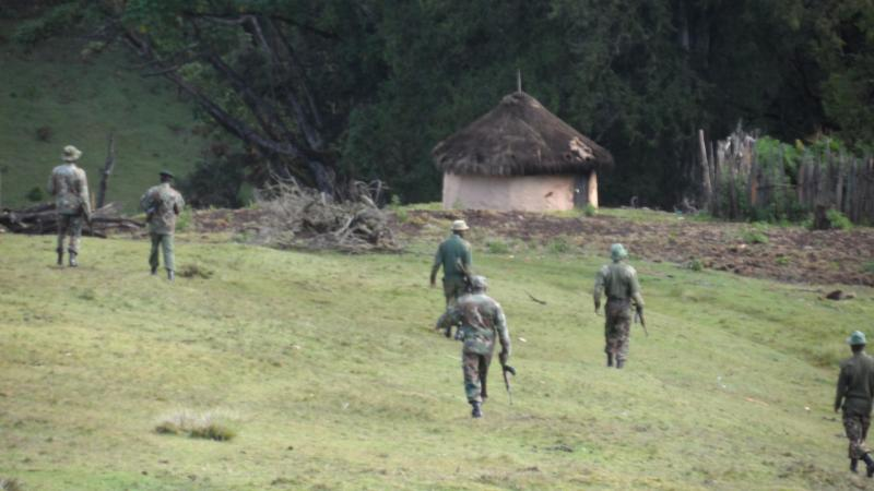 Guards approach a homestead, Embobut, Kenya 2014  (©  FPP)