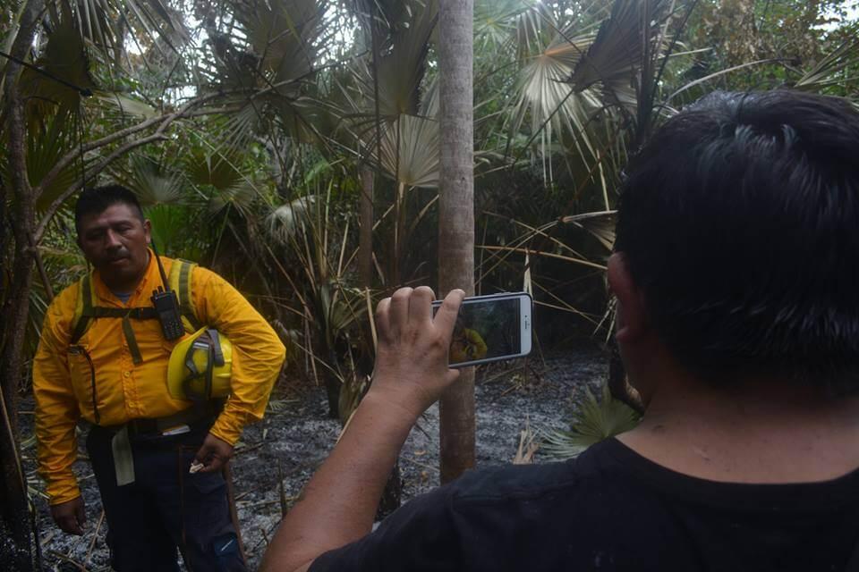 Pedro Canché interviewing a fireman