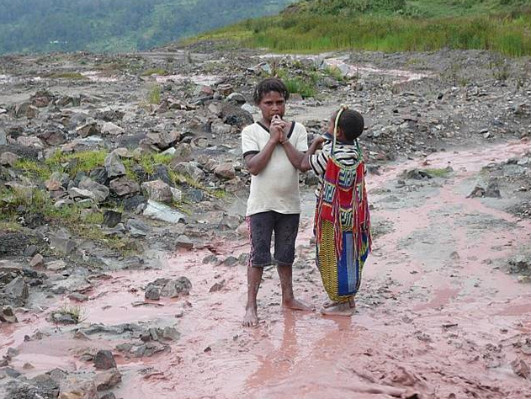 children-standing-in-tailings