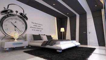ユニークな壁紙がインパクト大のおしゃれな寝室のインテリアのコーディネート