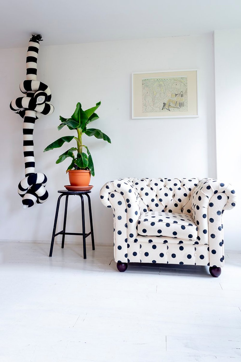 Polka dot chesterfield at the home of Annebet Philips