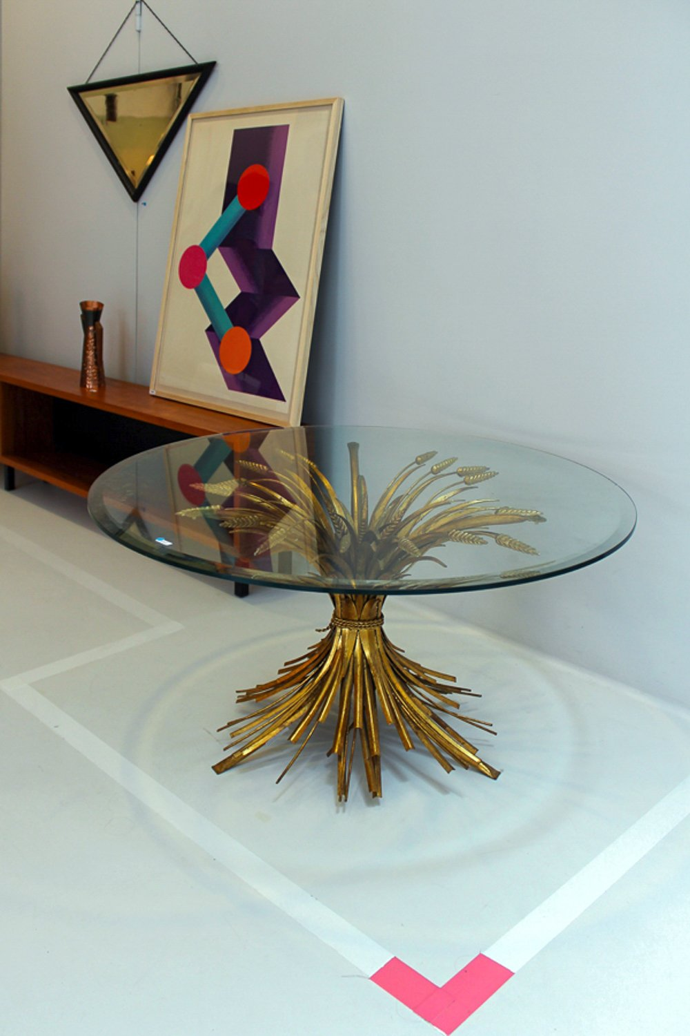 Hollywood Regency brass table /// More on Interiorator.com