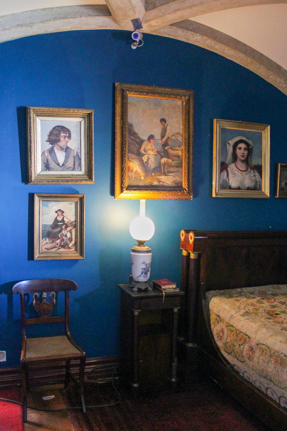 Blue bedroom with paintings