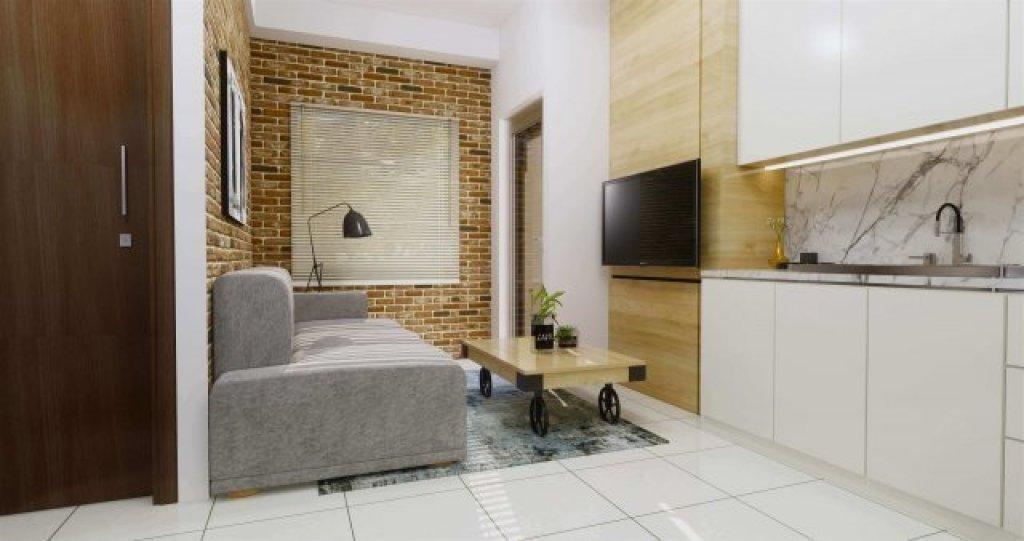 Interior ruang keluarga apartemen gaya industrial minimalis