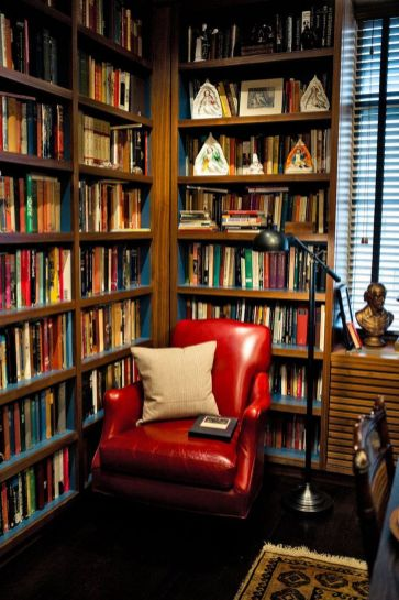 Love This Library And Chair In An Apartment ⊶ Via Nytimes #BookshelfIdeas