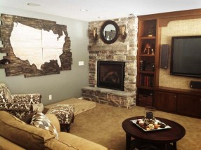 Basement Makeover: After - Cabinets were installed and a Fireplace added in the corner bring warmth and meaning to this space.