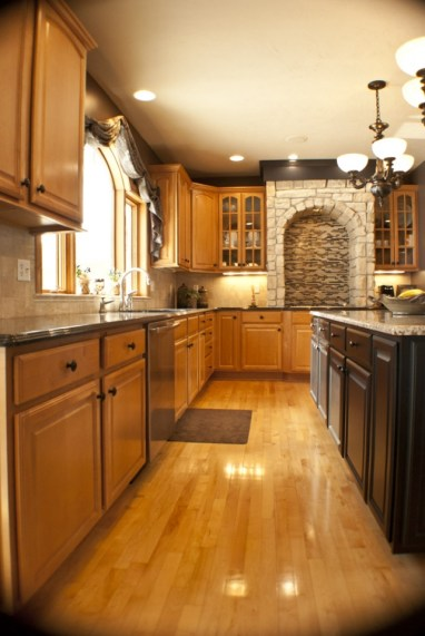 kitchen wood flooring rustic stove tile vent and back splash and stone surround