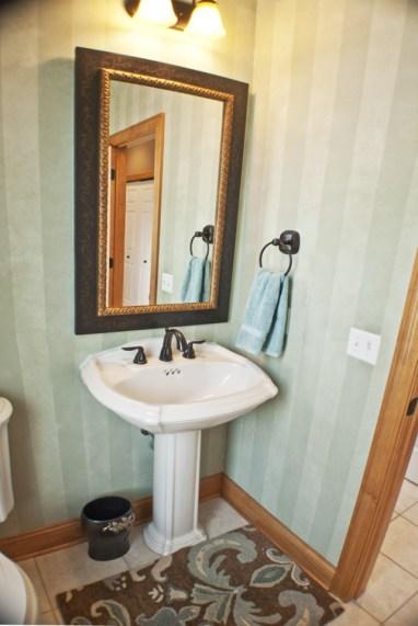 copper teal bathroom with pedestal sink