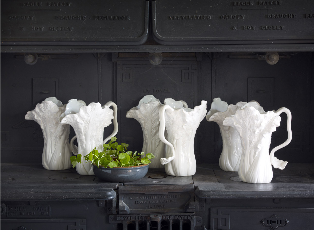 White Pitchers on Dark Gray Hutch