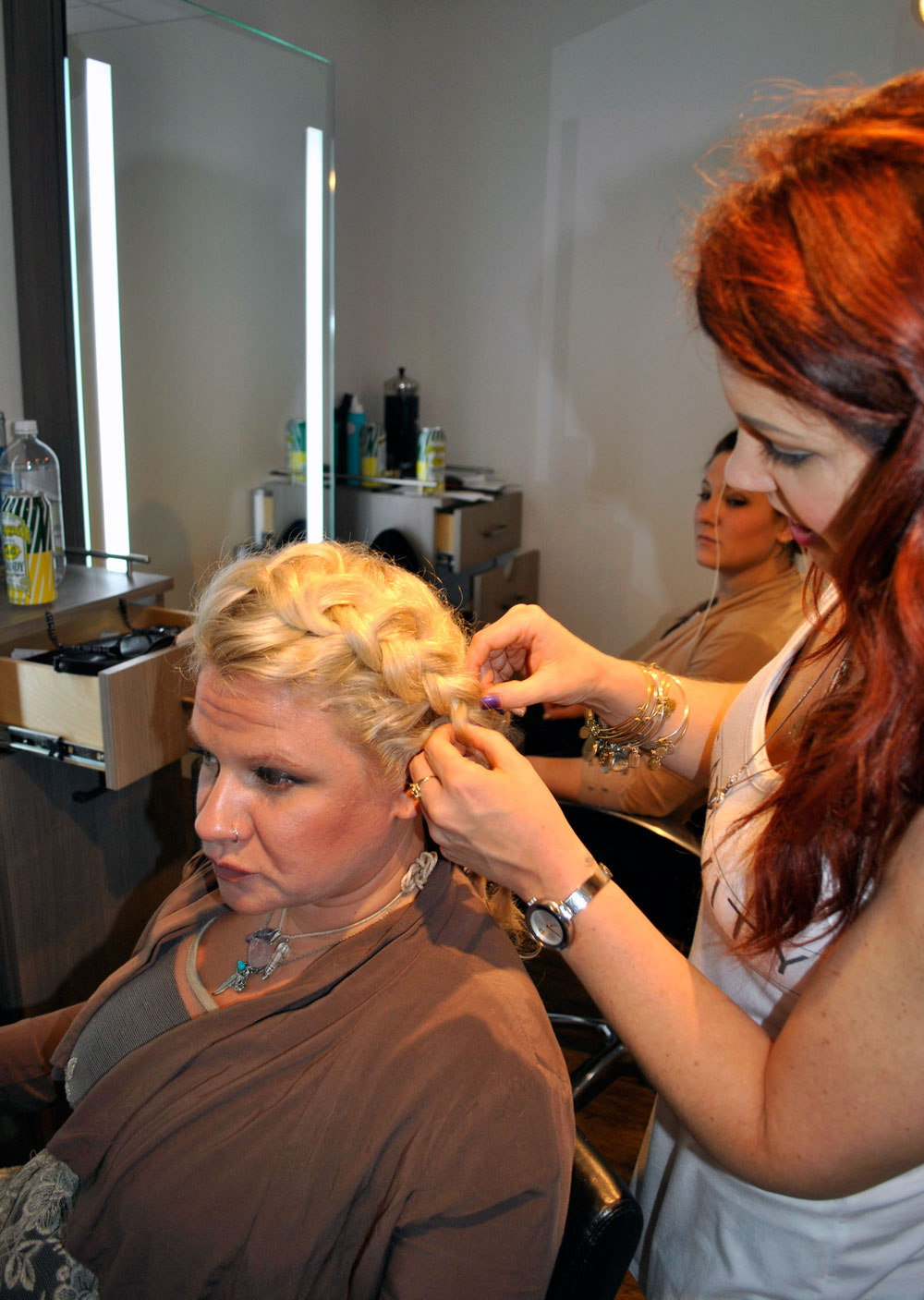 Stylists practicing updos at Shu Uemura education event