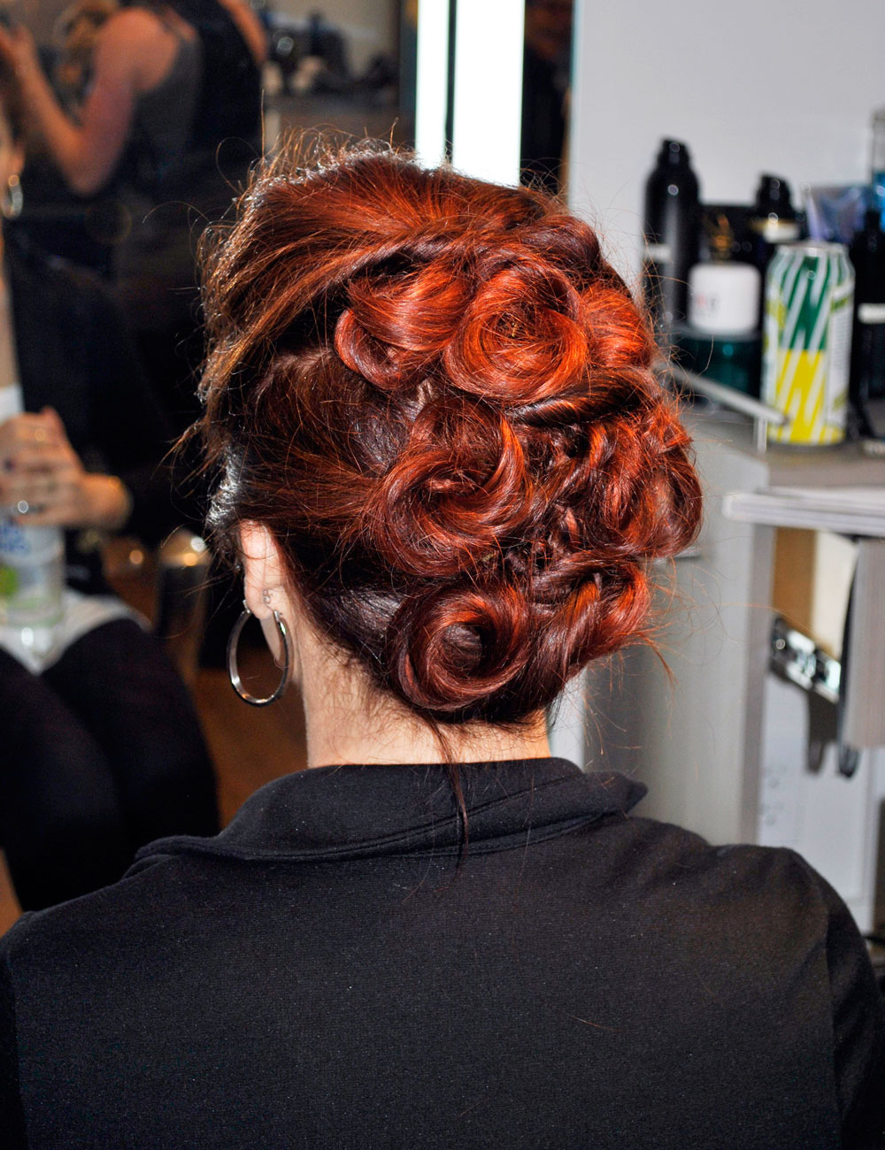 updo on stylist Tanya's red hair