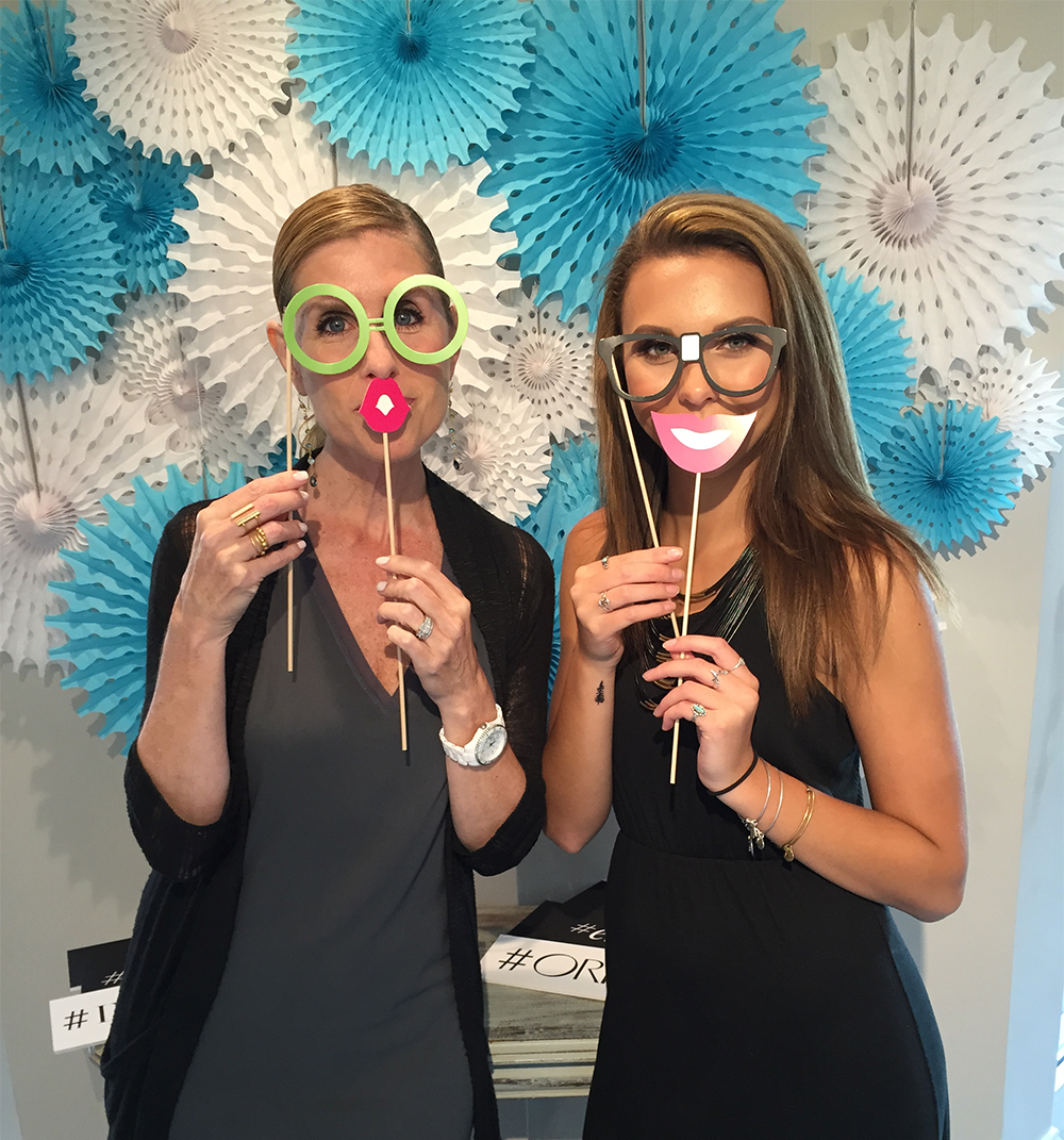 Robin and Noelle in photo booth during INTERLOCKS Effortless Summer hair and makeup event
