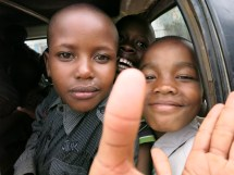After a day at the park, they're all in the matatu on the way home. Ambrose is on the right.