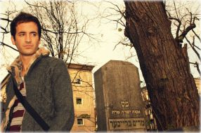 Walking through a Jewish cemetery in the Kraków Ghetto. This ghetto Ghetto was one of five major, metropolitan Jewish ghettos created by Nazi Germany in the new General Government territory for the purpose of persecution, terror, and exploitation of Polish Jews during the German occupation of Poland in World War II.