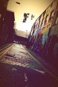 Brick lanes meet cobblestone streets lined with colorful