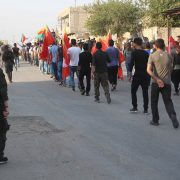 Assayish protecting the march in Derik