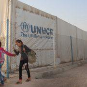 UNHCR  behind a fence