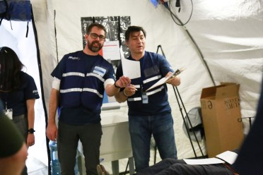 Dr. Colin Bucks (L), Clinical Assistant Professor, Emergency Medicine, Stanford, and Dr. Hernando Garzon (R), Global Health Program Director, Kaiser Permanente, participate in the field hospital simulation.