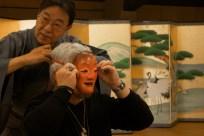 Bob Stigler tries on the Shojo mask