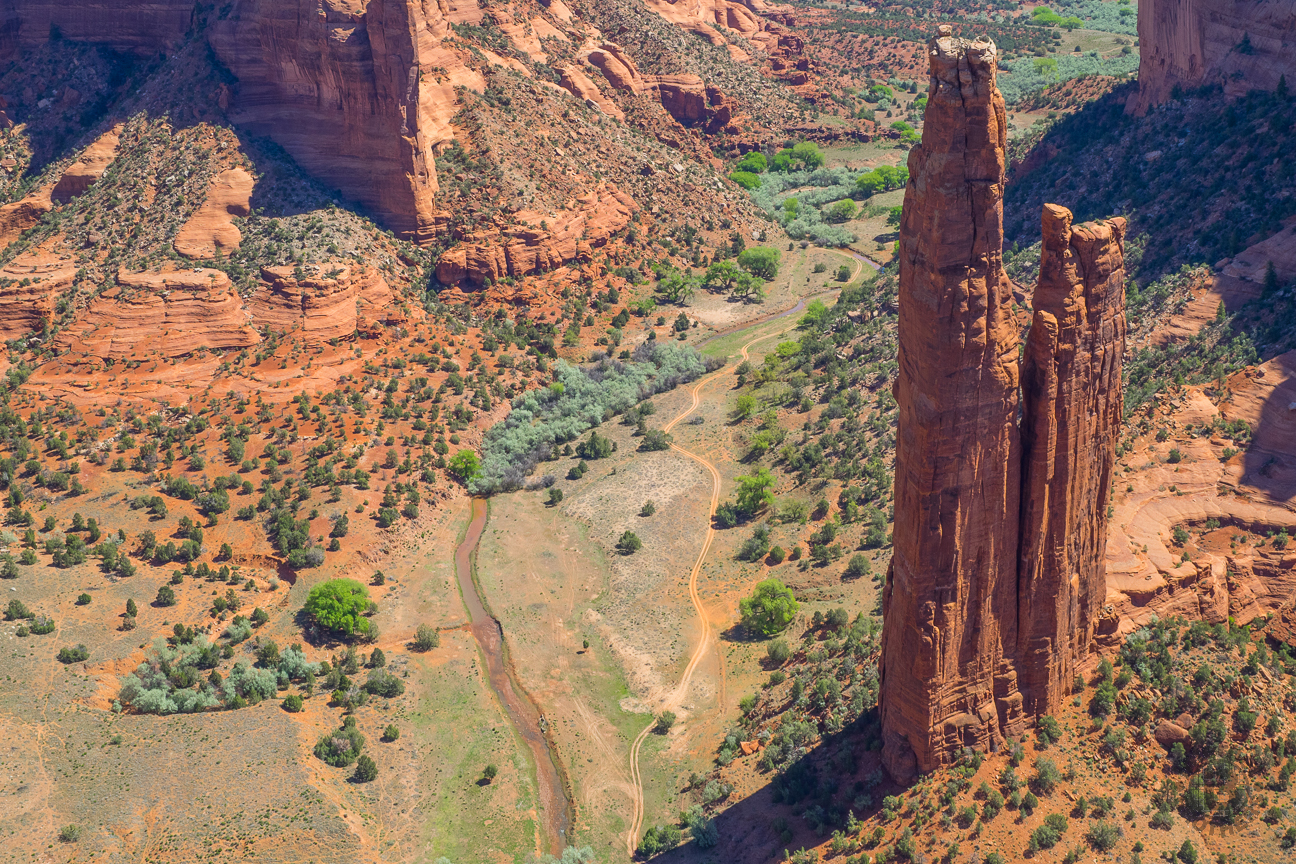 "Spider Rock is an 800-foot sandstone spire that rises from the canyon floor at the junction of Canyon de Chelly and Monument Canyon. From the overlook you can see the volcanic core of Black Rock Butte and the Chuska Mountains on the horizon. Traditional stories of the Diné elders tell of the ""Spider Woman"" who wove her web of the universe and taught Diné to create beauty in their own life and spread the ""Beauty Way"" teaching of balance within the mind, body, and soul."