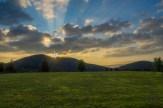 Crepuscular rays illuminate the sky