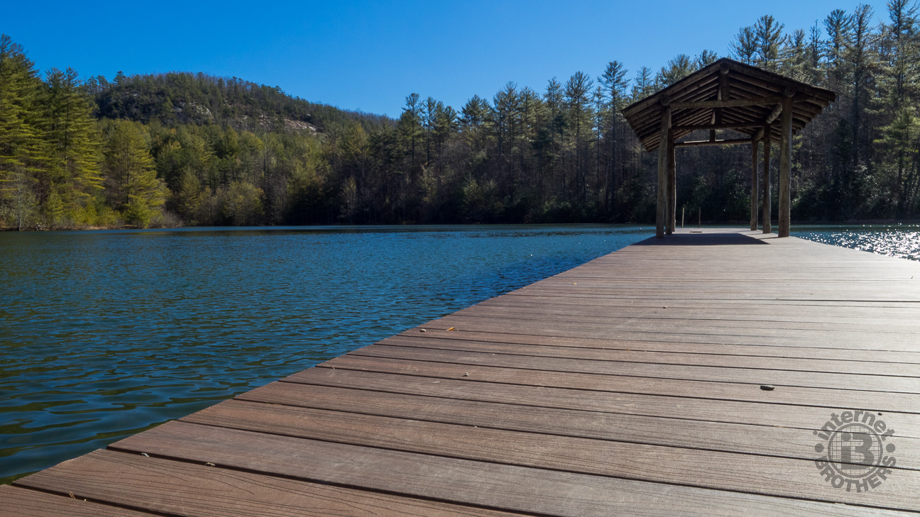 The west end of Lake Dense is a wonderful family attraction with a picnic shelter, two piers for swimming and diving, and of course fishing. Standing tall above the lake is the rugged cliff face of Joanna Mountain to the east.