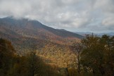 Mt. Pisgah is hidden by the cloud layer as it makes an effort to lift