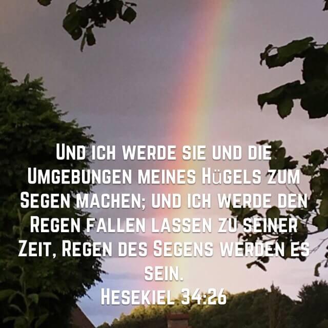 Bibelvers Hesekiel 34,26 auf Bild mit Regenbogen