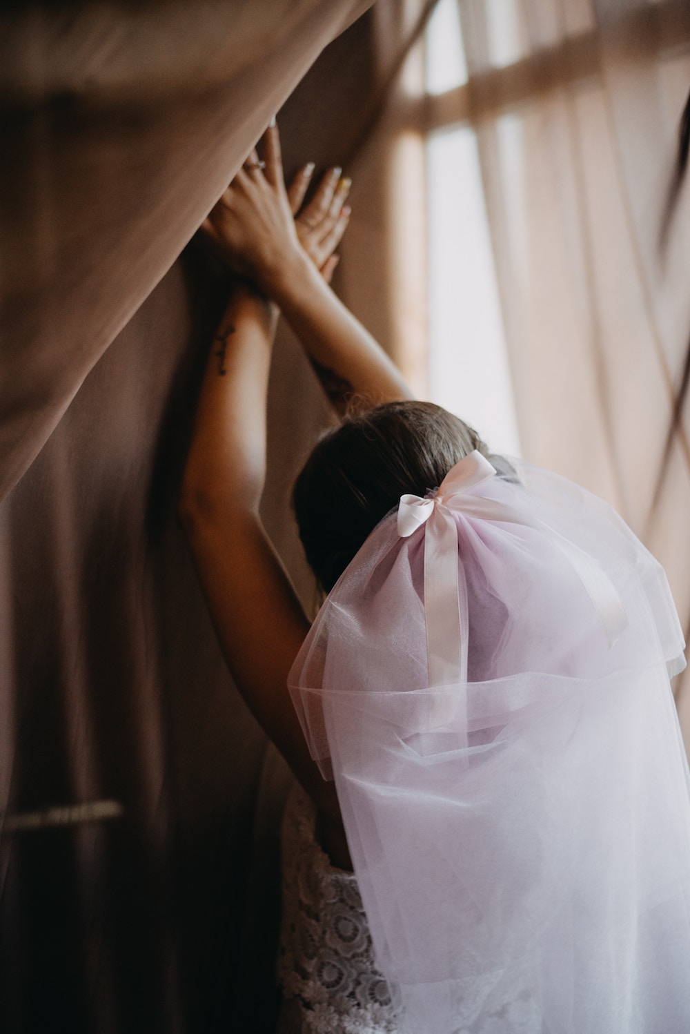 A bride with hands reaching upward