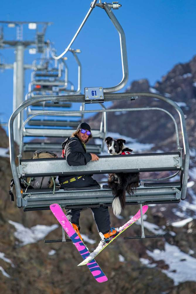 August 23, 2016 - Portillo, Chile: Avalanche dog Arva and his pal Fernando Gonzalez riding the Plateau chairlift.