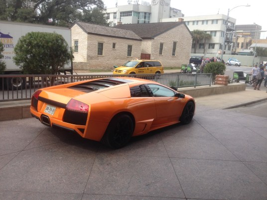 A sleek and pristine Lamborghini outside the Hilton in Austin