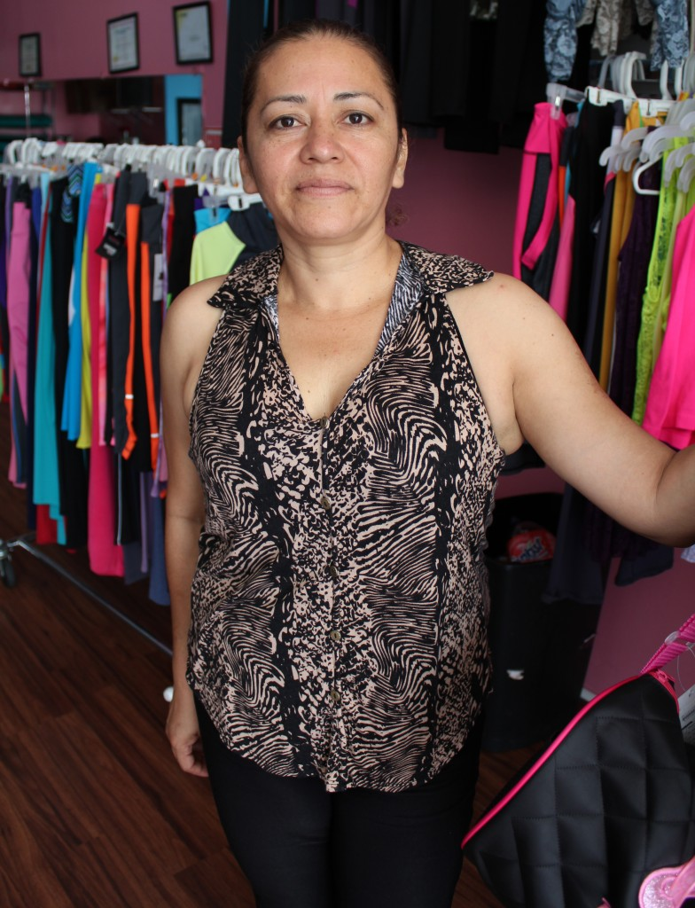 Santa Torijano sells colorful Zumba leggings and t-shirts to supplement her income from class fees. | Daina Beth Solomon
