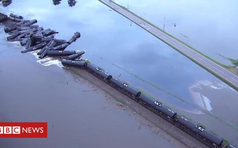 102173992 p06bx9g5 - Crude oil pours into river from derailed train in US