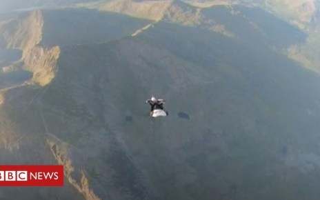 102268431 p06cgfc1 - Wingsuit flyer in Snowdon close proximity feat
