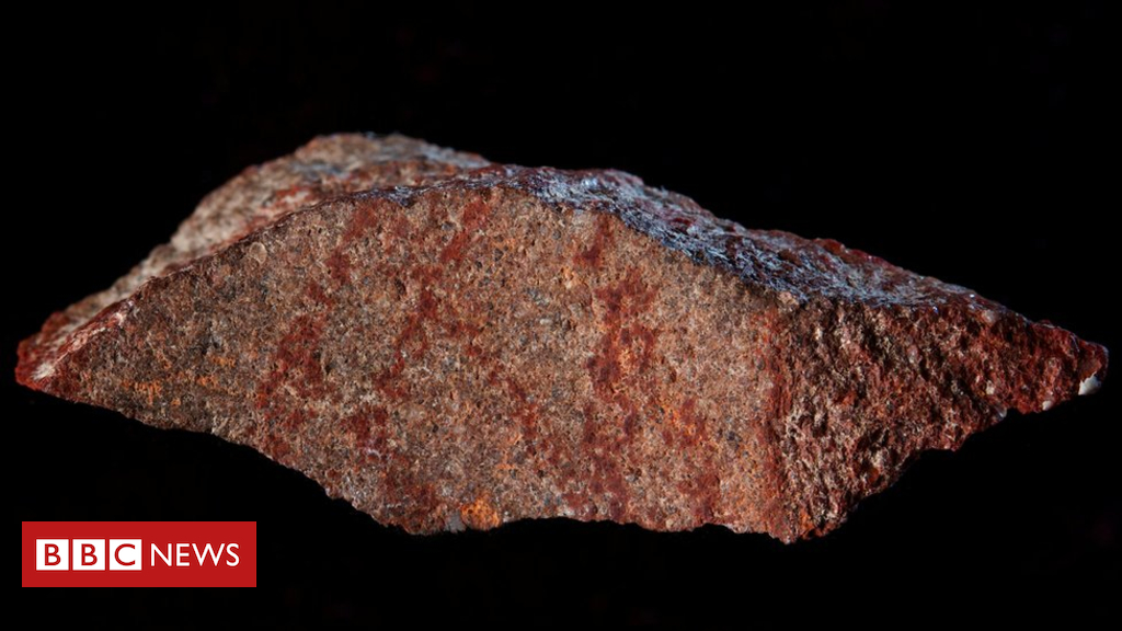 103397680 049239436 - 'Oldest known drawing' found on tiny rock in South Africa