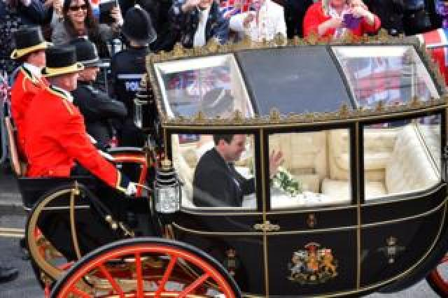 Princess Eugenie of York and her husband Jack Brooksbank leave in a carriage